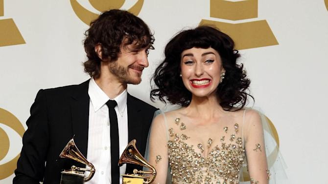 """Gotye, left, and Kimbra pose backstage with the award for best pop duo/group performance for """"Somebody That I Used to Know"""" at the 55th annual Grammy Awards on Sunday, Feb. 10, 2013, in Los Angeles. (Photo by Matt Sayles/Invision/AP)"""