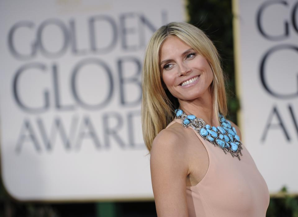 Heidi Klum arrives at the 69th Annual Golden Globe Awards Sunday, Jan. 15, 2012, in Los Angeles. (AP Photo/Chris Pizzello)