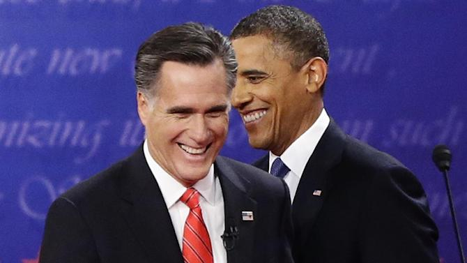 President Barack Obama and Republican presidential candidate and former Massachusetts Gov. Mitt Romney talk at the end of the first presidential debate in Denver, Wednesday, Oct. 3, 2012. (AP Photo/Charles Dharapak)