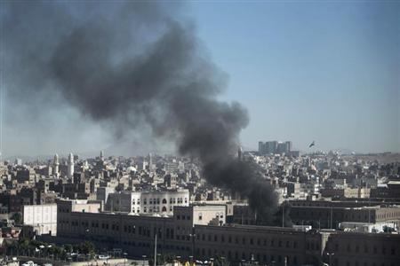 Smoke rises from the Defence Ministry's compound after an attack, in Sanaa
