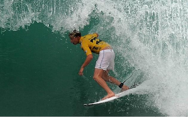 US surfer Koloche Andino competes in the Association of Surfing Professionals' men's 2012 ASP World Championship Tour at Barra da Tijuca beach in Rio de Janeiro, Brazil, on May 14, 2012.  AFP PHOTO/VA