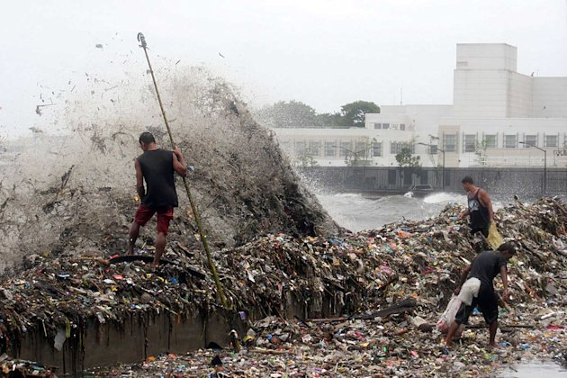 MANILA, Philippines - Scavengers collect plastic materials from tons of garbage washed ashore the Manila Bay seawall along Roxas Boulevard in Manila, on 01 August 2012, due to Tropical storm Gener. (NPPA Images)