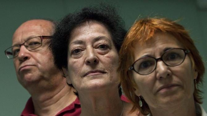 Maria Rumin, 55 years old, center, Jesus Rodriguez Barrios, 59 years old, left, and Felisa Echegoyen, 65 years old, right, pose for a portrait in Madrid, Spain, Monday, Sept. 23, 2013. Rumin, Echegoyen and Rodriguez, who claim they were tortured during Spain's Franco dictatorship say they hope new arrest warrants issued by Argentina will help bring some of the perpetrators to justice and finally open up a public debate on one of the country's darkest periods. The three told reporters Monday of routine arrests, beatings and torture during the near-40-year dictatorship that have never been investigated in Spain. Francisco Franco ruled Spain from 1939 until his death in 1975. (AP Photo/Andres Kudacki)
