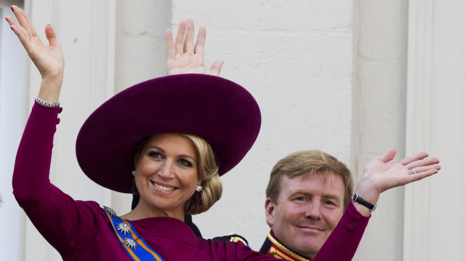 FILE - In his Sept. 18, 1012 file photo Princess Maxima, left, and Crown Prince Willem Alexander, wave to well wishers from the balcony of Royal Palace Noordeinde in The Hague, Netherlands. Prince Willem-Alexander's ascension to the Dutch throne in April 2013 promises to be a shining moment on the world stage for his wife Maxima and her home country of Argentina. But there will be a glaring absence at the ceremony. Queen Beatrix's announcement this week that she'll step aside and let her son become king raised new questions about the future queen's father, Jorge Zorreguieta, one of the longest-serving civilian ministers in Argentina's 1976-1983 military dictatorship.(AP Photo/Vincent Jannink, file)