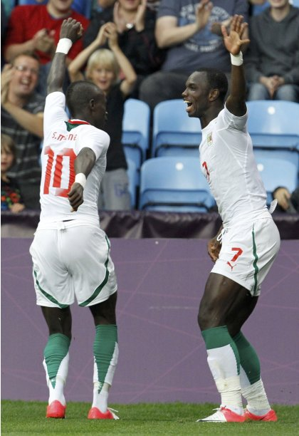 Senegal's Moussa Konate celebrates his goal with teammate Sadio Mane during their men's Group A football match against UAE at the London 2012 Olympic Games