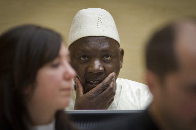 Congolese warlord Thomas Lubanga, center, awaits his verdict in the courtroom of the International Criminal Court (ICC) in The Hague, Netherlands, Wednesday, March 14, 2012. Judges have convicted a Co
