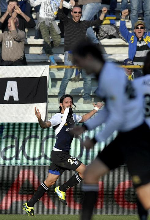 Parma's Ezequiel Schelotto celebrates after scoring a goal during a Serie A soccer match against Verona, at Parma's Tardini stadium, Italy, Sunday, March 9, 2014. Parma won 2-0