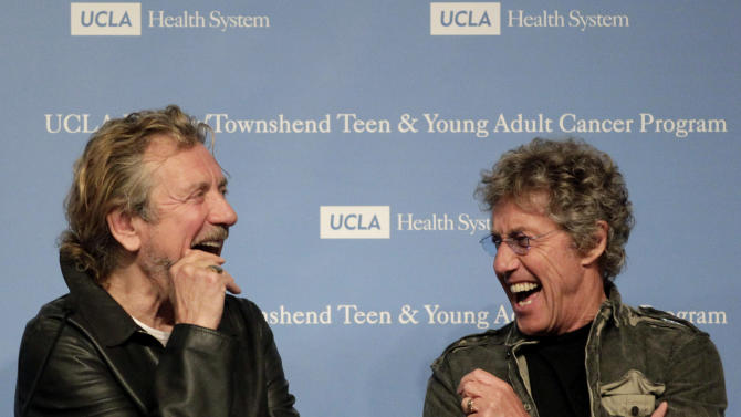 Roger Daltrey, right, of the British rock band The Who, and Robert Plant of Led Zeppelin laugh during a news conference at the Ronald Reagan UCLA Medical Center in Los Angeles, Friday, Nov. 4, 2011. Daltrey and Plant pledged to raise money to renovate part of the hospital pediatric floor into a separate space for patients ages 15 to 25. (AP Photo/Jae C. Hong)