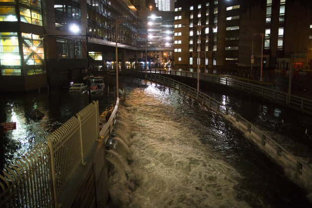 <p>               FILE - In this Oct. 29, 2012 file photo, sea water floods the entrance to the Brooklyn Battery Tunnel in New York during Superstorm Sandy.  A commission formed to examine ways to guard against storms like Sandy released a report Friday that calls for flood walls in subways, water pumps at airports and sea barriers along the coast. The final report was first obtained Tuesday, Jan. 8, 2013 by The Associated Press. The findings were officially released Friday, Jan. 11, 2013, by the office of Gov. Andrew Cuomo, who formed the commission.  (AP Photo/ John Minchillo, File)