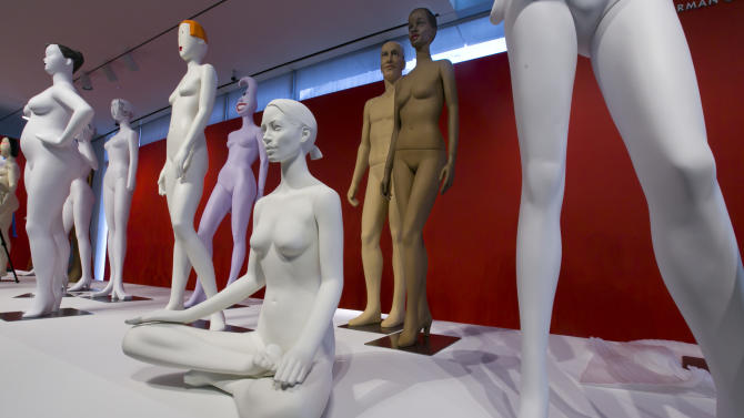 Mannequins are positioned during the installation of The Art of the Mannequin, by artist Ralph Pucci, at the Museum of Arts and Design, in New York on Thursday, March 26, 2015. (AP Photo/Richard Drew)