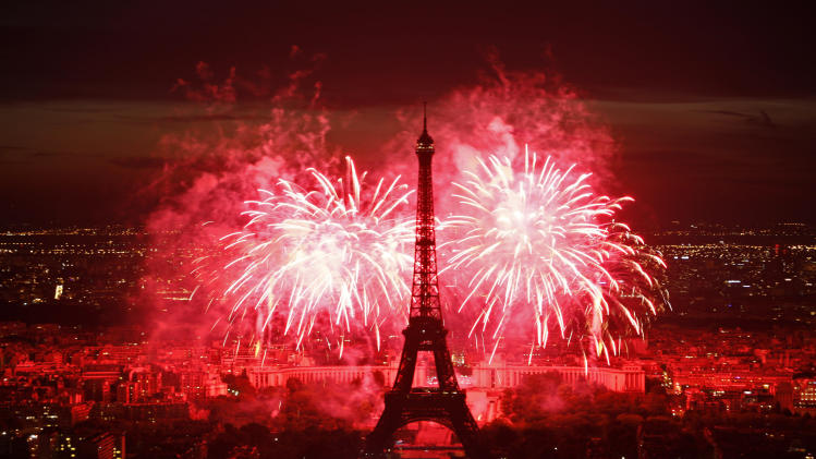 FILE - This July 14, 2011 file photo shows fireworks illuminating the Eiffel Tower in Paris during Bastille Day celebrations. (AP Photo/Thibault Camus, file)