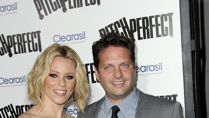 """FILE - This Sept. 24, 2012 file photo shows cast member and producer Elizabeth Banks, left, and her husband Max Handelman at the premiere of """"Pitch Perfect""""  in Los Angeles. Banks announced on her website Wednesday, Nov. 14,  the arrival of her son Magnus Mitchell Handelman, who was born via gestational surrogate. The new baby joins her older son, 20-month-old Felix, who also was born via surrogate after the couple faced infertility issues.  (Photo by Matt Sayles/Invision/AP, file)"""