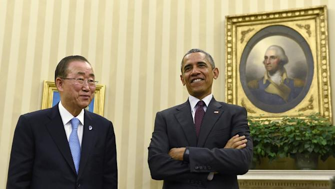 President Barack Obama stands up with United Nations Secretary-General Ban Ki-moon at the end of their meeting in the Oval Office at the White House in Washington, Tuesday, Aug. 4, 2015. (AP Photo/Susan Walsh)
