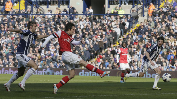 Arsenal's Tomas Rosicky shoots and scores his second goal against West Bromwich Albion during their English Premier league soccer match, at the Hawthorn's stadium in Birmingham, England, Saturday, April  6, 2013. (AP Photo/Alastair Grant)