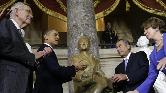 President Barack Obama, accompanied by, from left,  Senate Majority Leader Harry Reid of Nev., House Speaker John Boehner of Ohio, and House Minority Leader Nancy Pelosi of Calif., applaud at the unveiling of a statue of Rosa Parks, Wednesday, Feb. 27, 2013, on Capitol Hill in Washington. (AP Photo/Charles Dharapak)
