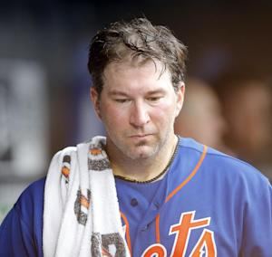 New York Mets losing pitcher Shaun Marcum leaves the dugout after their 2-1 loss to the Miami Marlins in  20-inning baseball game at Citi Field in New York, Saturday, June 8, 2013. Marlins won 2-1.(AP Photo/Paul J. Bereswill)