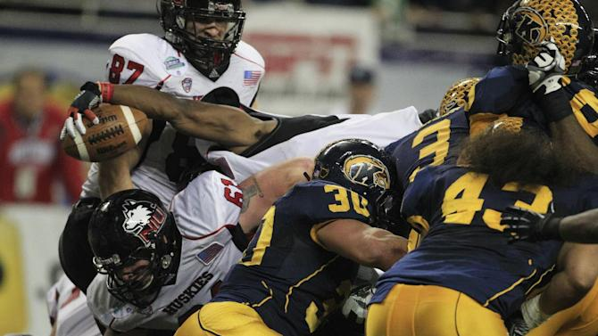 Northern Illinois running back Akeem Daniels scores a touchdown behind teammate Aidan Conlon (61) during the second quarter of the Mid-American Conference championship NCAA college football game against Kent State, Friday, Nov. 30, 2012. (AP Photo/Carlos Osorio)