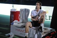 Andy Murray of Britain waits for the trophy ceremony after being beaten by Novak Djokovic of Serbia in the final of the Shanghai Masters tennis tournament in Shanghai. Having waited 76 years for a men's Grand Slam champion and 24 years to celebrate a women's tour winner, Britain, once the cash-heavy, running joke of world tennis, is suddenly a serious player