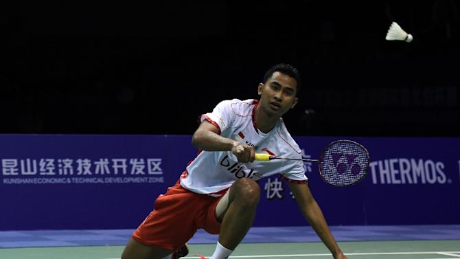 Tommy Sugiarto of Indonesia hits a return against Viktor Axelsen of Denmark at the Thomas Cup badminton tournament in Kunshan, China on May 22, 2016