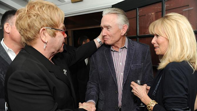 "From left, Elton John, Ian Telfer and Nancy Burke attend LoveGold/EJAF Celebrate ""How to Survive a Plague"" at Chateau Marmont on February 22, 2013 in Los Angeles. (Photo by Jordan Strauss/Invision for LoveGold/AP Images)"