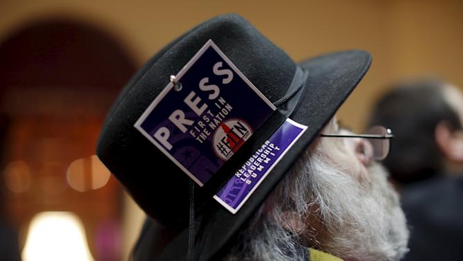A man wears his press credential in his hat at the First in the Nation Republican Leadership Conference in Nashua
