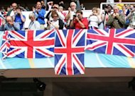 File picture shows British spectators at the 10th IAAF World Athletics Championships in Helsinki in August 2005. British sprint hope Adam Gemili clocked a personal best of 10.05 seconds to win the world junior 100 metres title in Barcelona late on Wednesday