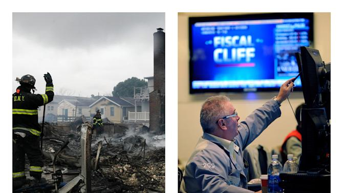 In this combination of Associated Press file photos, a firefighter surveys the smoldering ruins of a house in the Breezy Point section of New York, Tuesday, Oct. 30, 2012, left, and James Dresch of MND Partners Inc. works on the floor of the New York Stock Exchange Wednesday, Nov. 7, 2012 in New York, right. The combination of U.S. employers that shut down because of Superstorm Sandy and fears over looming tax increases and spending cuts likely slowed hiring sharply in November.  A private survey released Wednesday, Dec. 5, 2012, showed that companies added fewer workers last month than in October. (AP Photo)