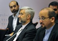 Chief Iranian nuclear negotiator Saeed Jalili (2nd L) takes part in the talks on the controversial Iranian nuclear programme in Moscow, in June. The US Congress Wednesday approved punishing new sanctions targeting Iran's energy and shipbuilding sectors, a day after President Barack Obama unveiled measures to cripple Tehran's nuclear drive