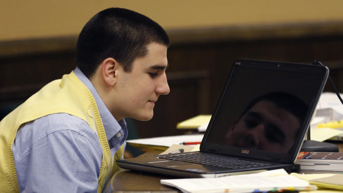 Trent Mays, 17, is reflected in the screen of a leptop as he sits at the defense table during a recess of his and co-defendant 16-year-old Ma'lik Richmond's trial on rape charges in juvenile court on Thursday, March 14, 2013, in Steubenville, Ohio. Mays and Richmond are accused of raping a 16-year-old West Virginia girl in August of 2012. (AP Photo/Keith Srakocic, Pool)
