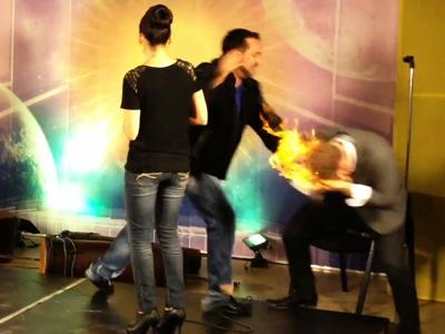 Raw: Magician burned as hair lights on fire