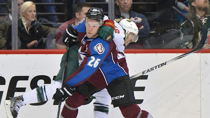 Colorado Avalanche center Paul Stastny (26) and Minnesota Wild defenseman Jared Spurgeon tangle in the second period during Game 7 of an NHL hockey first-round playoff series on Wednesday, April 30, 2014, in Denver