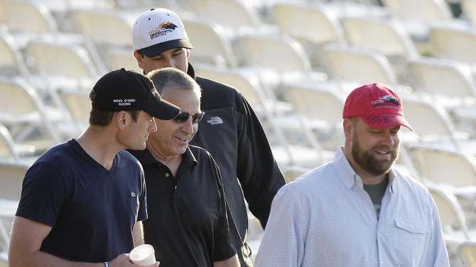 I'll Have Another trainer Doug O'Neill, right, walks in the stands during a morning workout at Pimlico Race Course, Friday, May 18, 2012, in Baltimore. The Preakness Stakes horse race takes place Saturday at Pimlico. (AP Photo/Patrick Semansky)