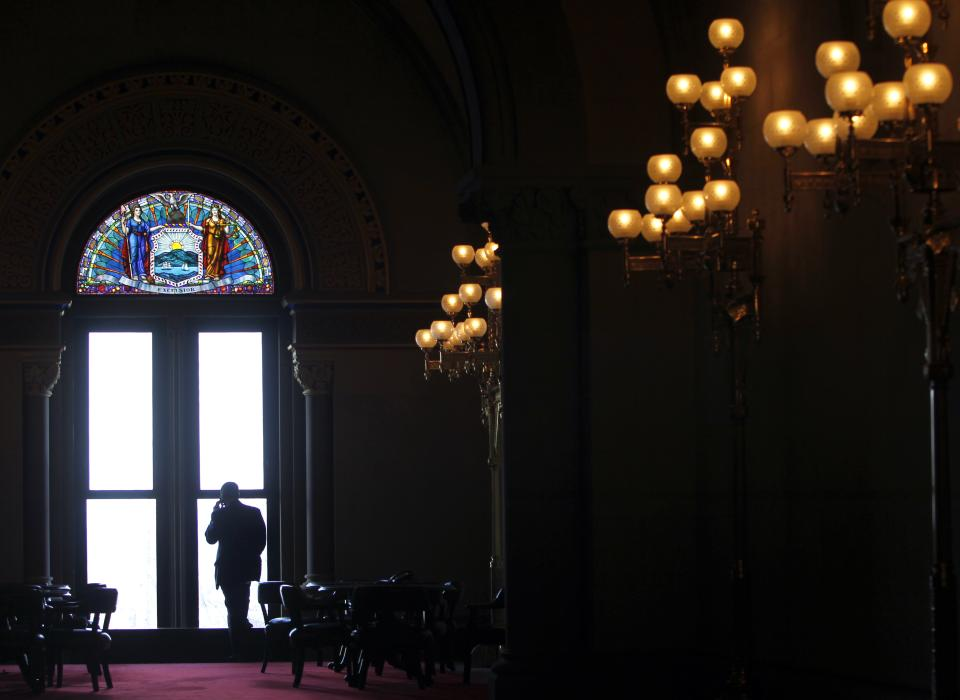 A man talks on a phone outside the Assembly Chamber at the Capitol in Albany, N.Y., Monday, Jan. 10, 2011.  Legislators open the first full week of the legislative session on Monday.  (AP Photo/Mike Groll)
