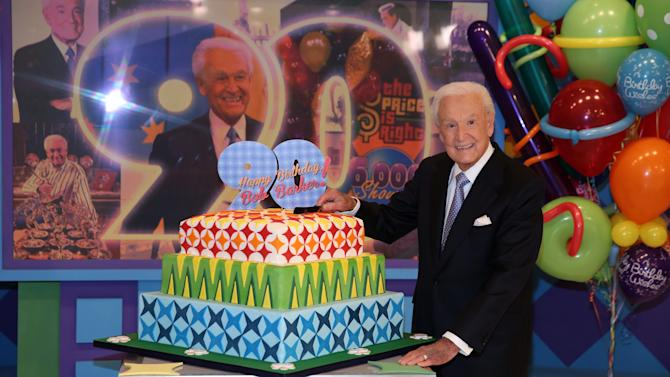 "This Nov. 5, 2013 photo shows Bob Barker posing on the set of ""The Price is Right"" with a cake celebrating his 90th birthday at CBS Studios in Los Angeles. The veteran game show host, at the helm of ""The Price is Right"" from 1972 to 2007, was invited back by current host Drew Carey on Thursday, Dec. 12, to celebrate the milestone birthday. (Photo by Matt Sayles/Invision/AP, File)"