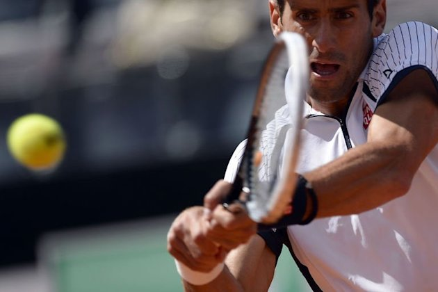 Serbia's Novak Djokovic returns a ball to Czech Republic's Tomas Berdych on May 17, 2013 at the Rome Masters