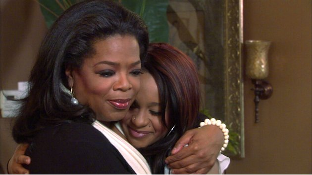 FILE - An undated image from video originally released by Harpo, Inc.,  shows host Oprah Winfrey, left, embracing Bobbi Kristina, daughter of the late singer Whitney Houston during an interview in Atl