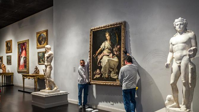 This Nov. 25, 2013, photo released by Los Angeles County Museum of Art shows an installation of a painting, St. Catherine of Alexandria, painted by Bernardo Strozzi at the Los Angeles County Museum of Art. The Baroque-era painting created in 1615 was looted by the Nazis in 1944 was installed at the Los Angeles County Museum of Art after it was returned to its owner and donated to LACMA. (Los Angeles County Museum of Art)
