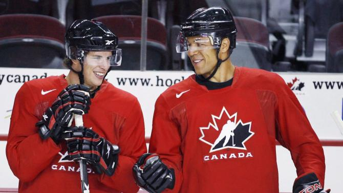Sidney Crosby, left, and Jarome Iginla, chat during a practice at the Men's National Olympic Hockey Team orientation camp in Calgary, Tuesday, Aug. 25, 2009. The Calgary Flames Hockey Club have traded team captain Jarome Iginla in exchange for forwards Kenneth Agostino and Ben Hanowski and the Pittsburgh Penguins 2013 first round pick. (AP Photo/The Canadian Press, Fred Chartrand, file)