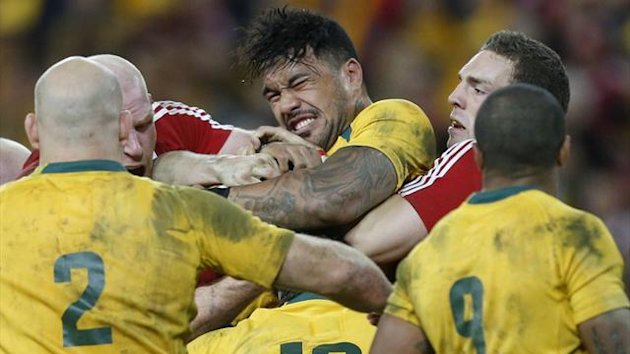 Australia Wallabies' Digby Ioane (C top) struggles to keep the ball during their rugby union test match against the British and Irish Lions at Suncorp Stadium in Brisbane June 22, 2013. (Reuters)