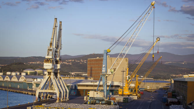 """Cranes are seen in the port of Koper, Slovenia, Tuesday, Sept. 25, 2012. Once the envy of the former European communist states because of its booming economy and Western-style living standards, Slovenia is becoming a showcase of failed transition, government mismanagement and bad loans. Andrej Plut has always thought he was fortunate to live in Slovenia, at one time the most prosperous of the former republics of Yugoslavia and a star among the eastern European states that joined the EU after the fall of communism. The 55-year-old dentist can't figure out what went wrong with his tiny Alpine state, which now faces one of the worst recessions and financial system collapses among the crisis-stricken 17-country group that uses the euro. """"We used to live so well,"""" Plut said. """"Now, we don't know what tomorrow brings."""" (AP Photo/Darko Bandic)"""