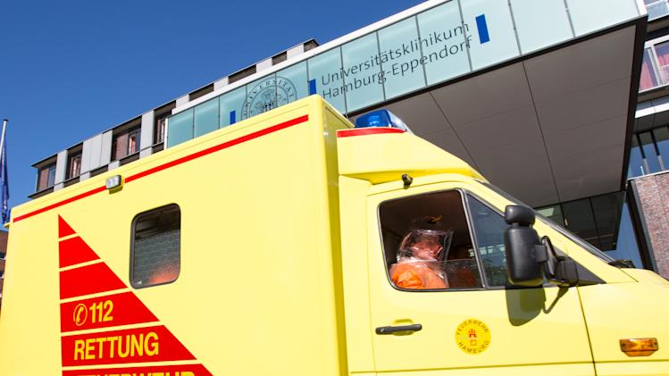 A man in special protection suit sits in an ambulance in front of the entrance of Eppendorf hospital in Hamburg, Germany, Wednesday Aug. 27, 2014. Officials say an epidemiologist who was infected with Ebola while working for the World Health Organization in Sierra Leone has arrived in Germany for treatment. Hamburg health department spokesman Roland Ahrendt said Wednesday the doctor would be treated in the city's UKE hospital at WHO's request. WHO spokeswoman Fadela Chaib said the patient is a man from Senegal who was working for the WHO as a consultant when infected by the virus in Sierra Leone. To date, the WHO says more than 240 health care workers have developed the disease in Guinea, Liberia, Nigeria and Sierra Leone, and more than 120 have died. (AP Photo/dpa,Georg Wendt)