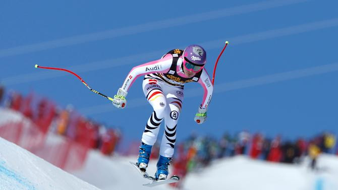 Germany's Maria Hoefl-Riesch speeds down the course on her way to placing second in an alpine ski World Cup women's downhill race, in Meribel, France, Saturday, Feb. 23, 2013. (AP Photo/Marco Trovati)