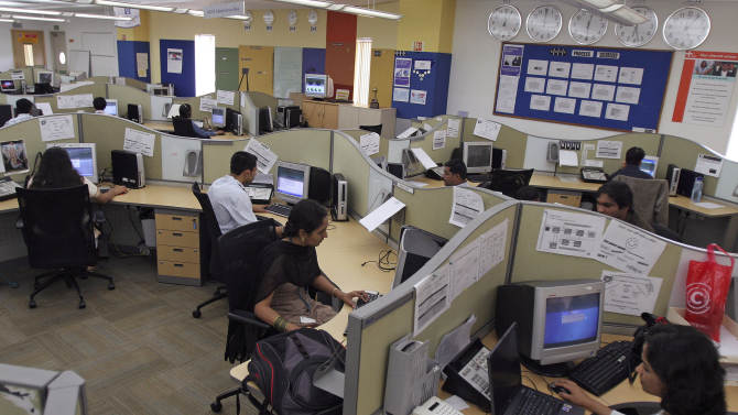 FILE- In this Aug. 7, 2007 file photo, Hewlett-Packard employees work at the company's Business Process Outsourcing center in Bangalore, India. Low cost efficiency put India's outsourcing companies at the heart of global business and created a multibillion dollar industry that for years has skated over criticism it was eliminating white collar jobs in rich nations. Now, the industry's long-held fears of a backlash are being realized in its crucial U.S. market. Provisions in an overhaul of U.S. immigration law will close loopholes that allow outsourcing companies, Indian and American, to pay guest workers in the U.S. at rates often below wages for equivalent-level Americans. (AP Photo/Aijaz Rahi, file)