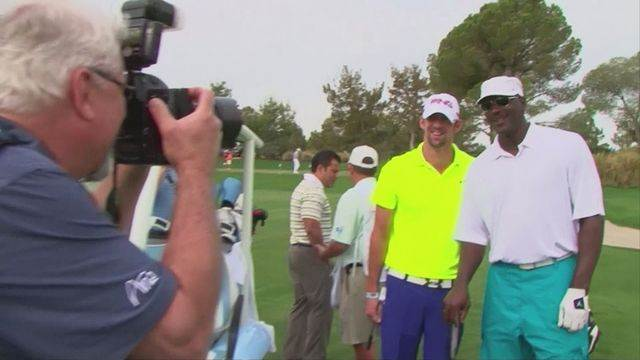 Phelps joins Michael Jordan on the golf course for charity [AMBIENT]