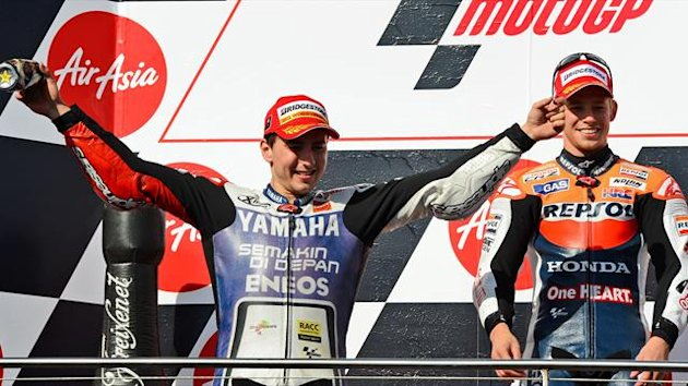 Jorge Lorenzo celebrates the title as Casey Stoner retires