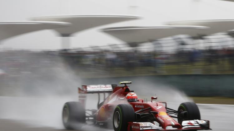 Ferrari Formula One driver Raikkonen of Finland drives during the qualifying session for the Chinese F1 Grand Prix at the Shanghai International circuit