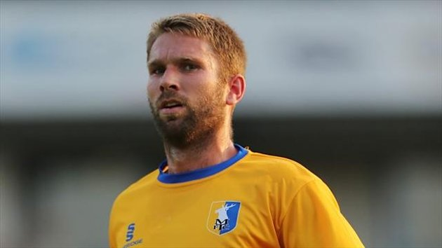 John McCombe has been allowed to leave Mansfield