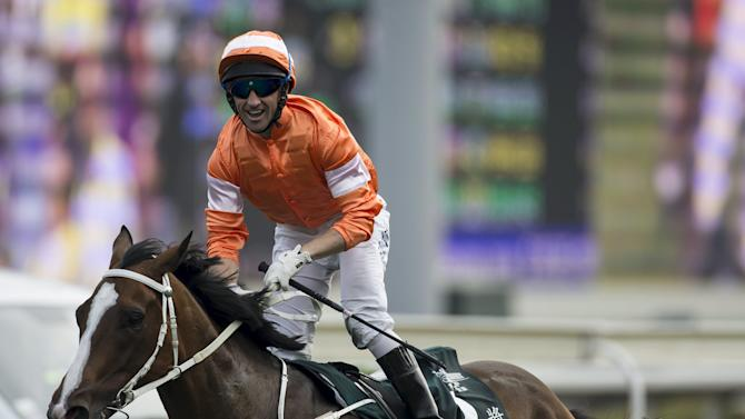 Irish jockey Callan smiles on Blazing Speed after crossing the finish line to win the 2,000m Audemars Piguet Queen Elizabeth II Cup Group One race at Sha Tin Racecourse in Hong Kong