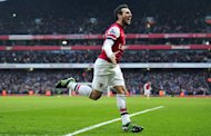 Arsenal's midfielder Santi Cazorla celebrates scoring during their English Premier League football match against Aston Villa at the Emirates Stadium in London on February 23, 2013