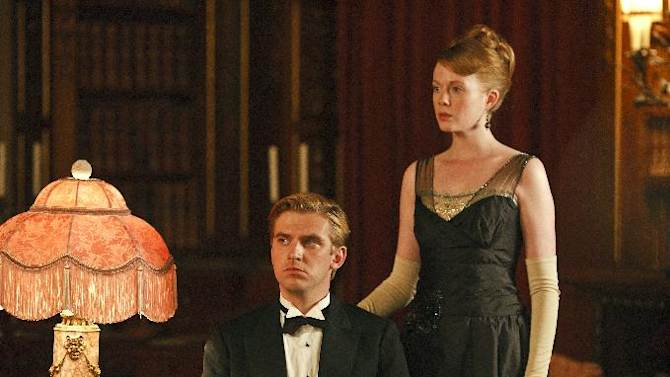 "In this image released by PBS, Dan Stevens as Matthew Crawley, left, and Zoe Boyle as Lavinia Swire are shown in a scene from the second season of ""Downton Abbey."" The 64th annual Primetime Emmy Awards will be presented Sept. 23 at the Nokia Theatre in Los Angeles, hosted by Jimmy Kimmel and airing live on ABC. (AP Photo/PBS, Carnival Film & Television Limited 2011 for MASTERPIECE, Nick Briggs)"